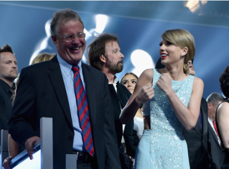 Taylor with Dad, Scott Swift listening to Andrea's Speech!